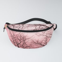 Naked trees tops, pink sky Fanny Pack
