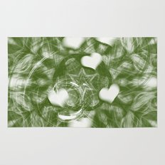 Fading hearts on forest green Rug