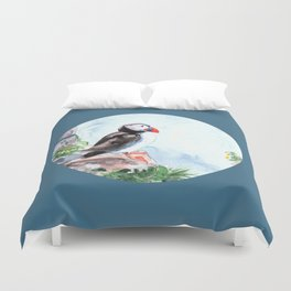 Puffin sitting on a rock with a blue background Duvet Cover