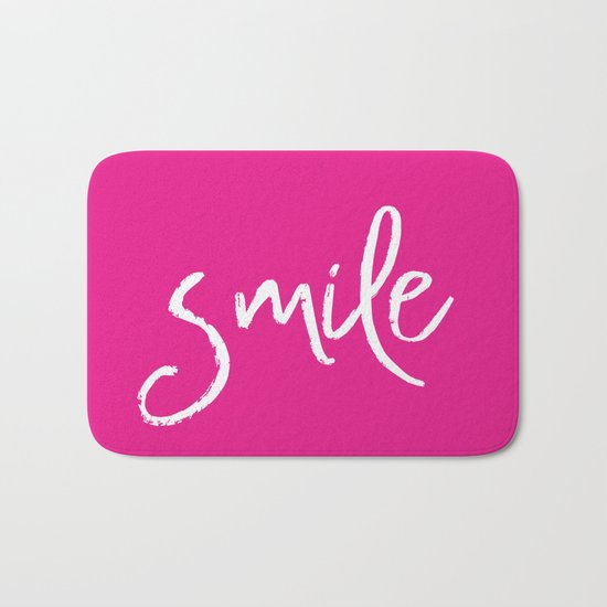Smile- Funny Typography on simple pink background texture on #society6 Bath Mat