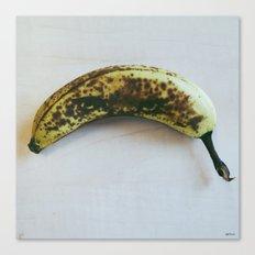 Leopard hiding in a banana Canvas Print