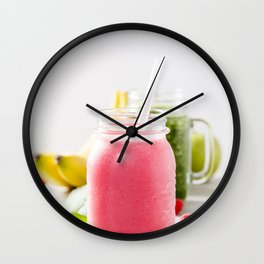 Close-up of pink fresh smoothie with fruits and berries selective focus. Wall Clock