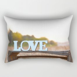 The inscription love stands on a wooden box. Romantic background. Nature background. Inscription made of wooden letters. Declaration of love. The 14th of February. Rectangular Pillow