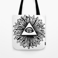 all seeing eye Tote Bags featuring All seeing camera eye by dsimpson