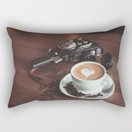 A cup of hot cappuccino placed on a table next to the old camera with lens and coffee beans Rectangular Pillow