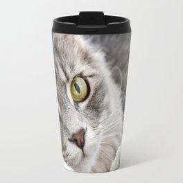 Cat lying with wide eyes open Travel Mug