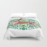 running Duvet Covers featuring RUNNING HARE by Riku Ounaslehto