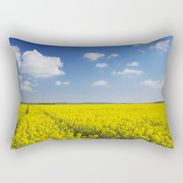 Path through blooming canola under a blue sky with clouds Rectangular Pillow