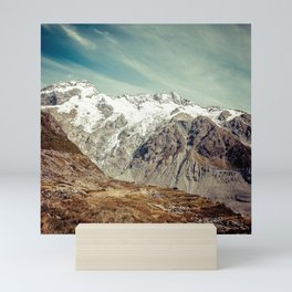 Snow-Capped Mountains Under Wispy White Clouds Mini Art Print