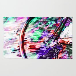 bicycle wheel with colorful abstract background in green red and purple Rug