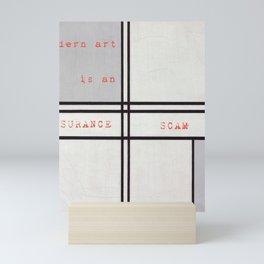 MODERN ART IS AN INSURANCE SCAM Mini Art Print