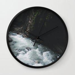 Water rushing down a rocky stream Wall Clock
