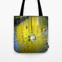 ducks Tote Bags featuring ducks by  Agostino Lo Coco