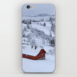 Snowy landscape with red house iPhone Skin