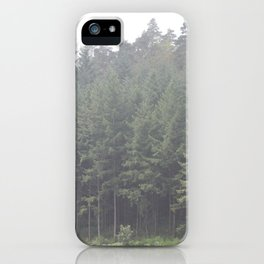 Pine trees Perfectly lined up in the mist. iPhone Case