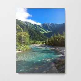 River flowing in front of snow covered mountain Metal Print