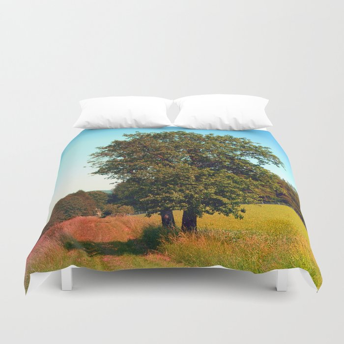 Old tree, vibrant surroundings Duvet Cover