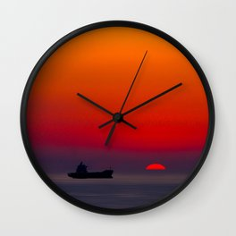 Silhouette of a ship on the ocean at red sunset with half sun ball at the horizon Wall Clock