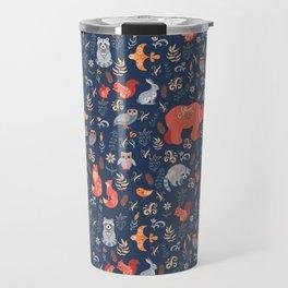 Fairy-tale forest. Fox, bear, raccoon, owls, rabbits, flowers and herbs on a blue background. Seamle Travel Mug