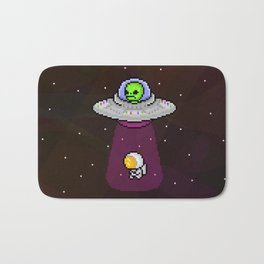 Alien in a spaceship abducting an astronaut Bath Mat