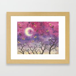 chickadees and io moths in the moonlit sky Framed Art Print