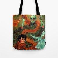 deathly hallows Tote Bags featuring The Deathly Hallows by Angela Rizza
