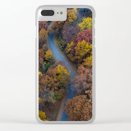 Bird's eye view of a winding road among autumn trees Clear iPhone Case