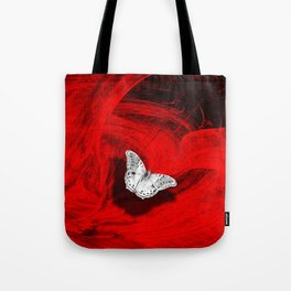 Silver butterfly emerging from the red depths Tote Bag