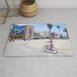 Riding bike in Venice Beach Rug
