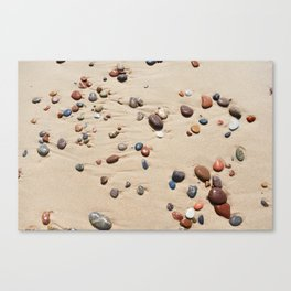 Wet sand and stones on beach Canvas Print