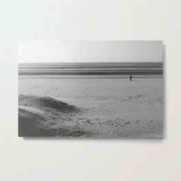 Beach in winter with some walkers Metal Print