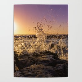Magical sunset and waves breaking over rocky beach Poster