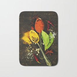 Bright spices on an old  wooden board Bath Mat