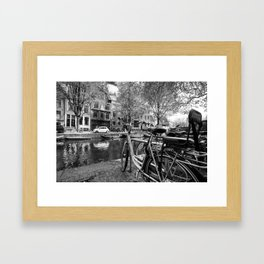Bicycles and boats along Amsterdam canal Framed Art Print