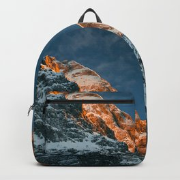 Glowing mountain at sunset Backpack