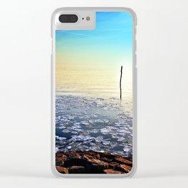 Sun going down in calm frozen lake Clear iPhone Case