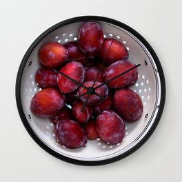 Some violet plums in a white glazed colander. Wall Clock