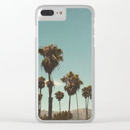 Palm trees before the mountain foot Clear iPhone Case