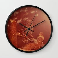 the who Wall Clocks featuring who. by Rae Snyder