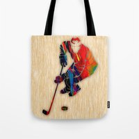 hockey Tote Bags featuring Hockey by marvinblaine