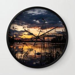 Sun sets on the bridge Wall Clock