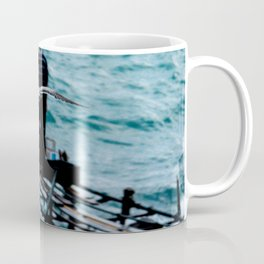 Flight of the seagull towards the fisherman. Coffee Mug