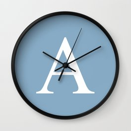 Letter A sign on placid blue color background Wall Clock
