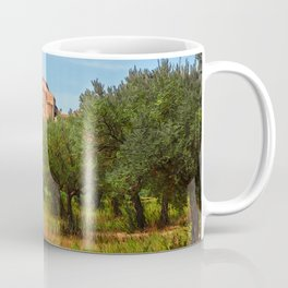 Medieval Abbey among olive trees in Italy Coffee Mug