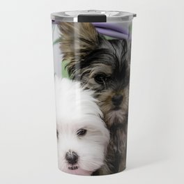Maltese Puppy and a Yorkshire Terrier Puppy Cuddling in a Purple Basket with Flower Background Travel Mug