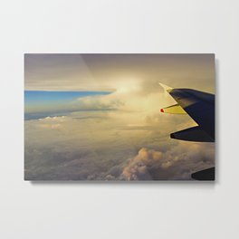 Wing of an airplane at sunrise Metal Print