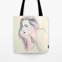 cara Tote Bags featuring Cara by Guadalupe Jiménez