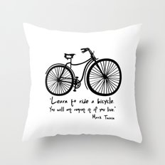 Learn to ride a bicycle. You will not regret it if you live. Throw Pillow