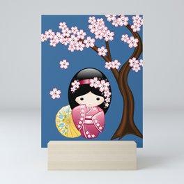 Japanese Spring Kokeshi Doll on Blue Mini Art Print