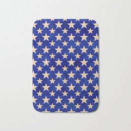 Gold stars on a dark blue background. Bath Mat